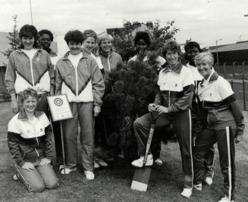 England players planting 'Their Tree' for the community at the 7th World Tournament in Glasgow. Front: Ann Cush, Jillean Hipsey (Captain), Anne West (Manager). Middle: Kendra Lowe (Slawinski), Sheila Byrne(Edwards). Back: Joan Bryan, Karen Fenlon, Maggie Lewellen(Jackson).