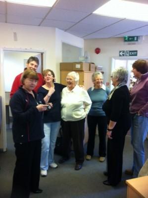 Cheryl Danson, Cathy Hickey, Sheelagh Redpath, Jean Bourne, Joan Mills, Jan Burke and Kendra Slawinski discussing old photographs   Yvonne Bacon