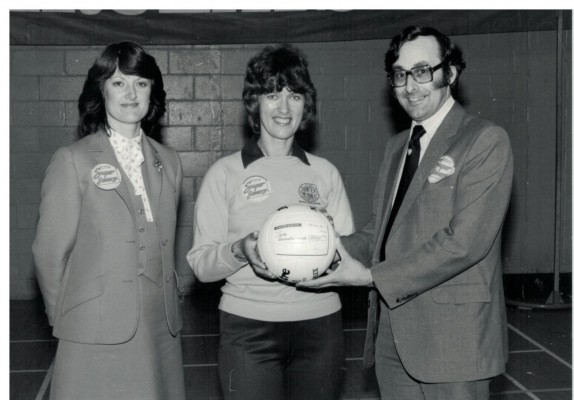 A cheque being received by Coach Gerry Cornwell 1983