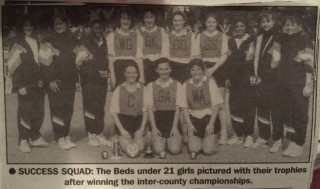 A newspaper photograph of the Bedfordshire under 21 team with their trophy after winning the inter-county championships