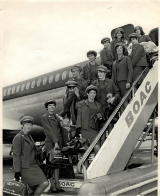 Boarding at London Airport off to Australia for the 2nd World Tournament. Left side of stairs:  Liz Kelly, Isabel Martindale,  Eunice Charles, Pat Green, Joyce Wheeler, Ann Miles, Janice Bannister. Right side of steps: Judy Day, Jackie Bowley, Ann Davies, Marion Lofthouse (Captain), Phyliss Edwards.
