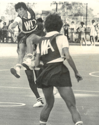 Sue Keal (WD) at her most athletic against St Kitts.