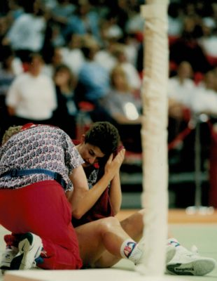 Lisa Topliss  having treatment after a clash of heads. | Niels Carruthers