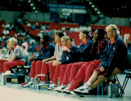 Team bench watching intently. | Niels Carruthers