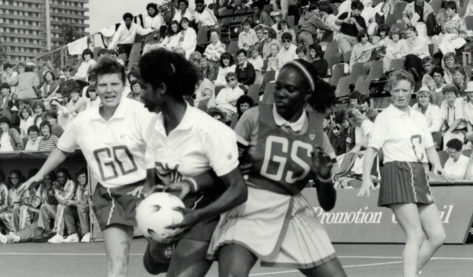 Jess Parkes (GK) intercepting against Barbados, with Kendra Lowe (GD) and Ann Cush (C)