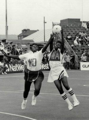 Maggie Farrell (WD) in action against Trinidad & Tobago