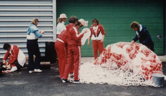 Some of the England Squad members prepare to celebrate Jillean's 100th Cap by blowing up 100 red and white balloons - helping with the preparations is Mary Beardwood (centre) and Kendra Lowe (front left).