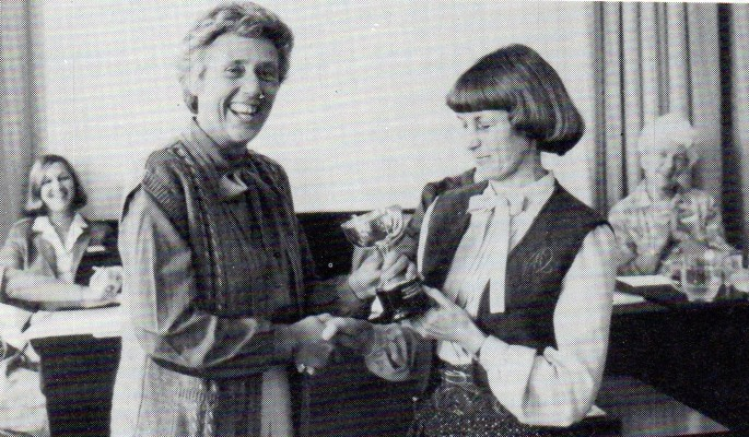 Jean Gall (right) receiving the trophy from Almena Theobald.