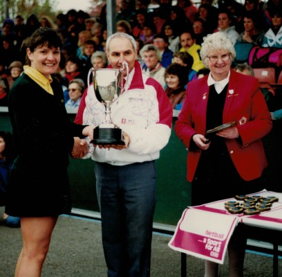 Winners (Seniors) Surrey being presented the Evian Cup and Pat Taylor | Sandra Smith