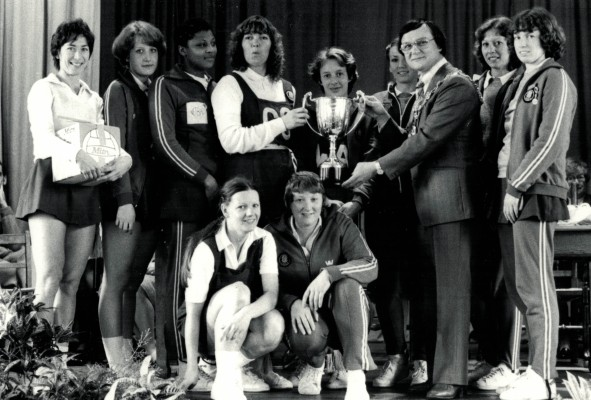 Senior champions, Essex Met receiving the trophy from the Mayor of Rochdale. Back row:  Jillean Hipsey (captain), ???, ???, Pat Cane/Meadows,Sue Collins, ???, Mayor , Pat Watson, Gill White.  Front row;  ???, ???