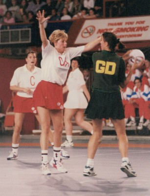 Tracey Miller (GA) defending the pass out with Lucia Sdao (C) in the background