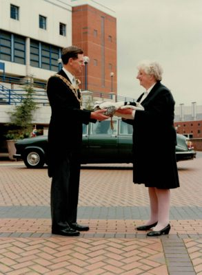 Pat Taylor handing over the IFNA flag to the Mayor of Birmingham