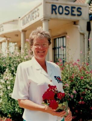Winner Helen Watt with a bunch of Rising Star roses