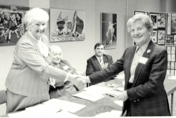 Pat Taylor presenting Nora Ashworth with Life Membership, Lily McGurk and Gordon Padley in the background