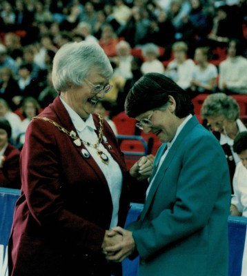 Jean Bourne, England President presenting Jean Perkins with her Life Membership Award