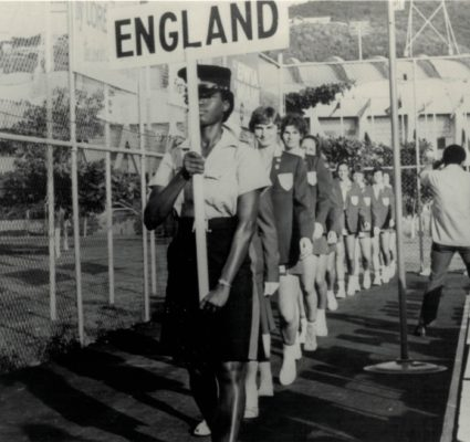 England being led out with Captain Ann Miles