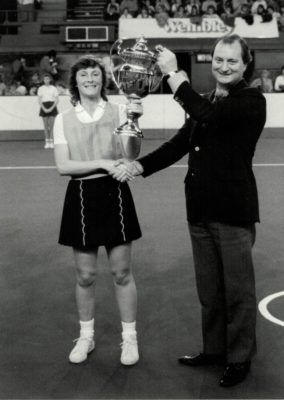 Hertford Hornets Captain, Julia King receiving the winners Robinson's Barley Water Trophy from Dick Tracey, Minister of Sport