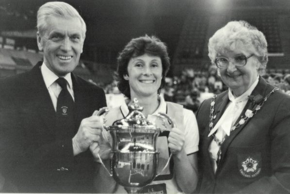 Hertford Hornets Captain, Julia King with Ken Woolcott presenting the Robinson's Barley Water Trophy, and Pat Taylor
