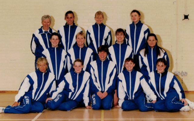 Champions East Region Back row: Les Jones (coach), Louise Sheridan, Jane Mitchell, Anne Marie Muller Middle row: Jackie Manson, Justine Saunders, Gill White, Chrissy Maskell Front row: Sue Collin, Avril Woods, Kendra Lowe, Fiona Murtagh, ????