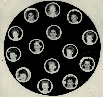 A joint photograph of the England and Scottish teams.  Outer ring starting at the top:  Margaret Moore, Peta Tiptaft, Cathy Hickey,  Elizabeth Gavin Scotland, Marie Fairie Scotland, ??? Scotland, ??? Scotland, Joan Church Scotland, Helen Michell, Jane Manser.  Inner ring starting at the top:  Eunice Charles (England Captain), Judi Day, LIz McPheeley Scotland, Mary Grindley Scotland.
