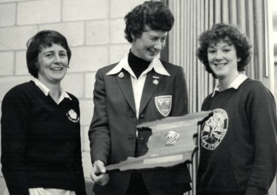 Senior Captain Sue Keal and Under 21 Captain ???? receiving the Trinidad & Tobago Trophy from Annette Cairncross