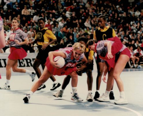 Bit of a tussle and Tracey Neville with the ball, ?, and Lucia Sdao (WA)