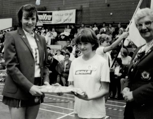 Kirsty McNaughton, hole in the heart, presented with a memento by Kendra Lowe, England Captain and Pat Taylor, President at the England v Northern Ireland match