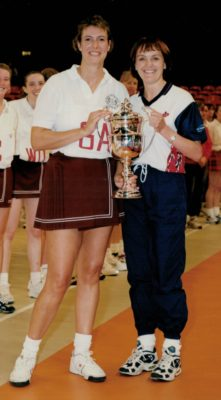 New Cambell Captain Lisa Gross receiving the Wembley Clubs Knockout Tournament Trophy from England Captain, Fiona Murtagh