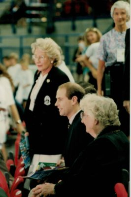 HRH Prince Edward with Pat Taylor, President on his left and Cheryl Dawson, President of New Zealand on his right sitting down to watch the games
