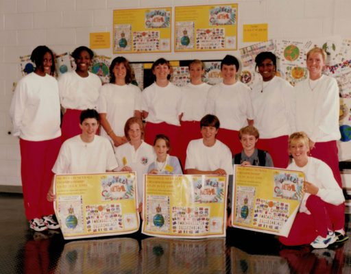 England Netball Tournament Squad with the winning poster and the children involved.