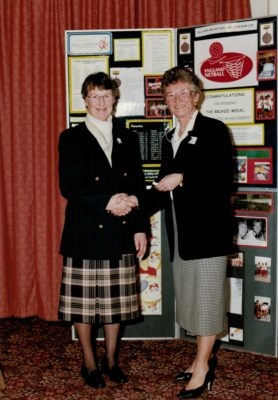 Sylvia Eastley presented with her Honorary Life Membership by Joan Mills, Chairman