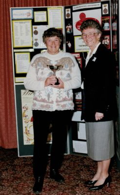 Jean Jones presented with the Muriel McNally Trophy by Joan Mills