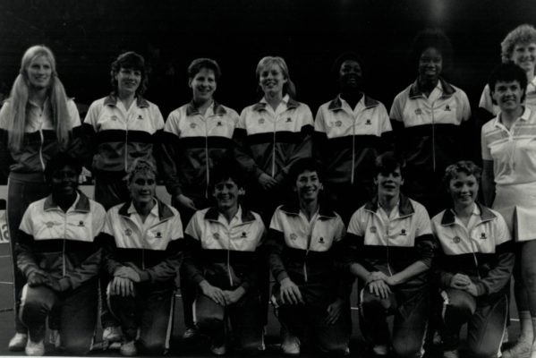 England Squad: Back Row: Heather Crouch (coach), Kendra Lowe, Karen Fenlon, M LLanelly, Joan Bryant, Jess Parkes, Helen Cadman, Maureen Lee (umpire) Front Row: Maggie Farrell, Wendy Toogood, Sue Keal, Jillen Hipsey (captain), Colette Thomson, Ann Cush | David Katz