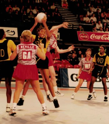 Loosing the ball.  Tracey Neville (GA), Lisa Stanley and Helen Lonsdale (WA)