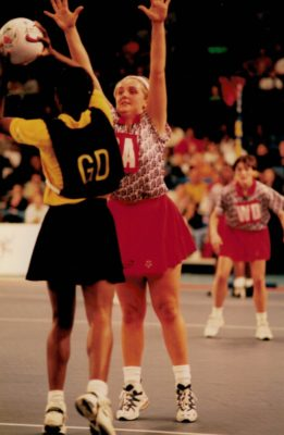 Tracey Neville (GA) defending pass out with Fiona  Murtagh in support (WD)