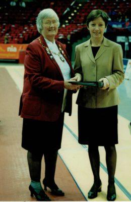 Jean Bourne, President presenting Liz Nichol, CEO with a retirement portfolio.