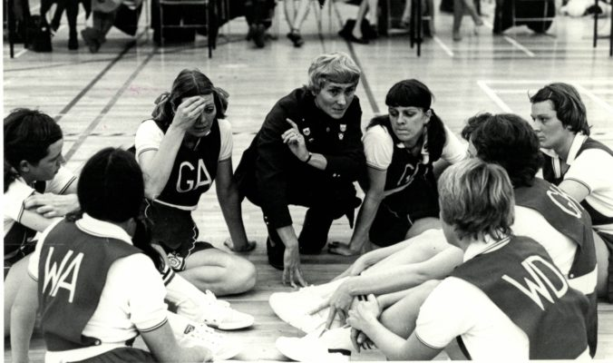 England Team talk from coach Joyce Wheeler Far left is GS Gwen Foster.   GA Pat Cane (now Meadows).   Joyce Wheeler (Coach)   GD Denise Hunter (now Pilgrim) WA is Helen Fradley.  WD is Sarah Marriott (now James)  Next to Sarah on her right is Maddy Dwan (now Hartwell) Far right is Carol Bretherton | Brian Worrell