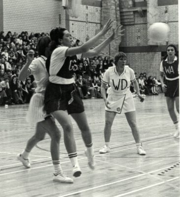 Gwen Foster England GS receiving a pass into the circle under pressure from ROOS GK Anne Miles.   WD Marion Lofthouse | Brian Worrell