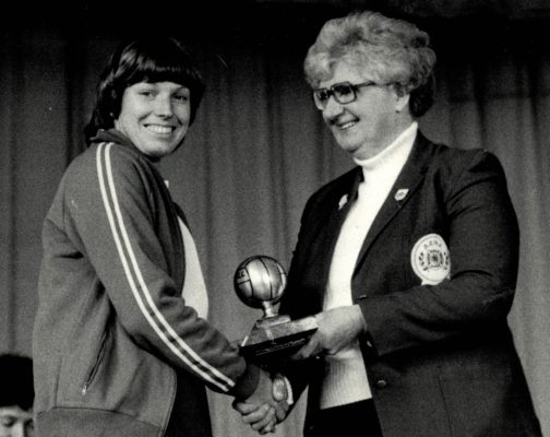 Essex Met Under 21 Captain Gill White receiving the League Trophy from AENA President Pat Taylor