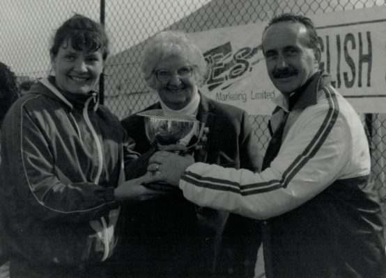 Shelia Hartley receiving winners cup, with Pat Taylor
