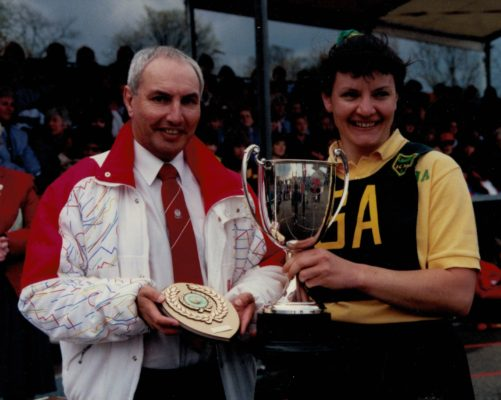 Sheila Edwards, Surrey Captain receiving the winners cup from Richard Foulsham of Evian Water.