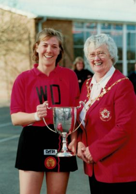 Jean Bourne, President awarding the Winning Cup to Middlesex