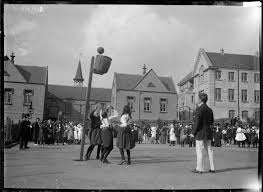 Early photograph showing the goal basket instead of the later goal rings circa 1900