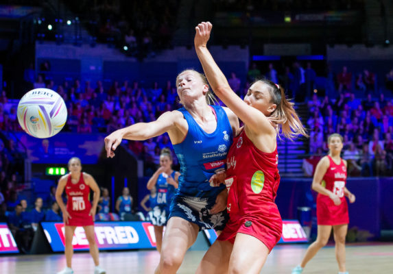 Picture by Allan McKenzie/SWpix.com - 13/07/2019 - Netball - Vitality Netball World Cup - England v Scotland - M&S Bank Arena, Liverpool, England - Claire Maxwell challenges for the ball with Jade Clarke. | SWpix.com