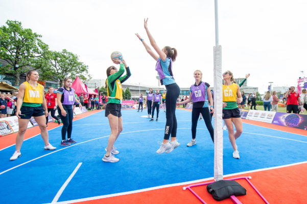 Picture by Allan McKenzie/SWpix.com - 17/07/2019 - Netball - Vitality Netball World Cup - M&S Bank Arena, Liverpool, England - The brief, Northern Ireland playing with the fans and supporters on the half court in the fanzone. | SWpix.com
