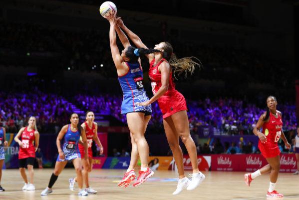 Picture by Alex Whitehead/SWpix.com - 14/07/2019 - Netball - Vitality Netball World Cup 2019 - England v Samoa - M&S Bank Arena, Liverpool, England - Tee Salanoa of Samoa and Geva Mentor of England. | SWpix.com