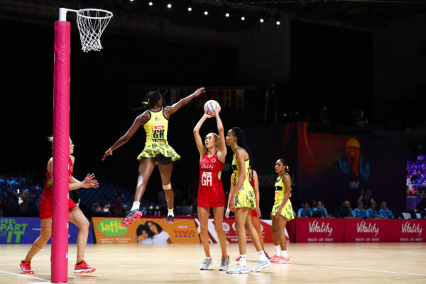 Picture by Alex Whitehead/SWpix.com - 15/07/2019 - Netball - Vitality Netball World Cup 2019 - Jamaica v England - M&S Bank Arena, Liverpool, England - Kadie-ann Dehaney of Jamaica and Helen Housby of England. | SWpix.com