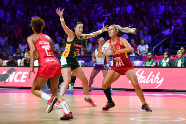 Picture by Simon Wilkinson/SWpix.com - 18/07/2019 - Netball - Vitality Netball World Cup 2019 - South Africa v England - M&S Bank Arena, Liverpool, England - Chelsea Pitman of England and Shadine Van Der Merwe of South Africa. | SWpix.com