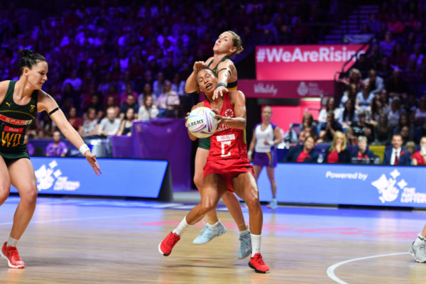 Picture by Simon Wilkinson/SWpix.com - 18/07/2019 - Netball - Vitality Netball World Cup 2019 - South Africa v England - M&S Bank Arena, Liverpool, England - Serena Guthrie of England and Erin Burger of South Africa. | SWpix.com