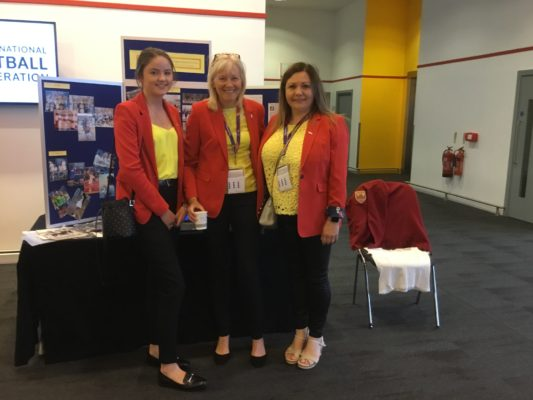 England Heritage display at INF Congress.  Delegates from Isle of Man (Pip Cross centre)